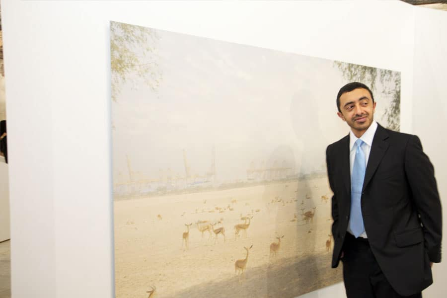 Minister of Foreign Affairs, HH Sheikh Abdullah bin Zayed Al Nahyan with artwork from Observers of Change