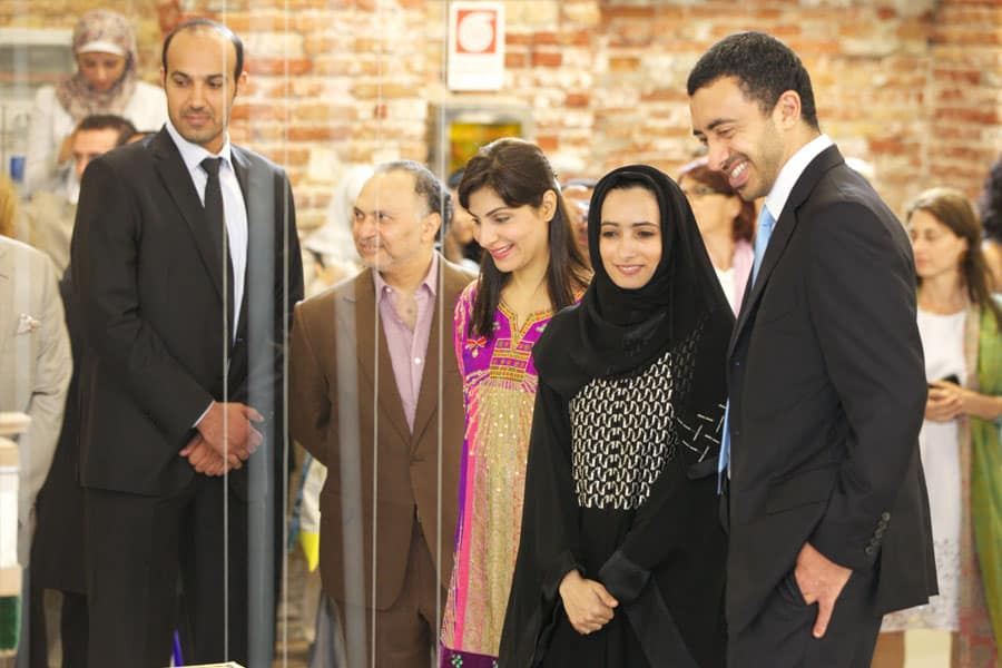 Minister of Foreign Affairs, HH Sheikh Abdullah bin Zayed Al Nahyan with artist Reem Al Ghaith, observing Dubai: What's Left of my Land. 2011, Installation, mixed media, 8 x 8m.