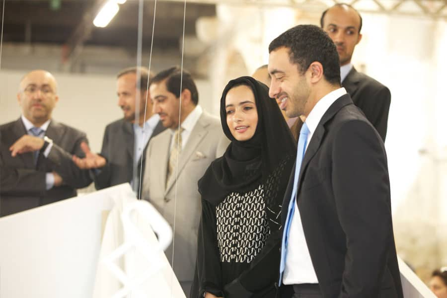 Minister of Foreign Affairs, HH Sheikh Abdullah bin Zayed Al Nahyan with artist Reem Al Ghaith observing Dubai: What's Left of my Land. 2011, Installation, mixed media, 8 x 8m.
