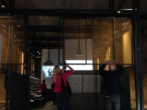Visitors interacting with the hanging screens